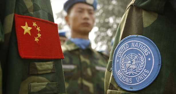 Close up of soldier clothes with China and UN flags