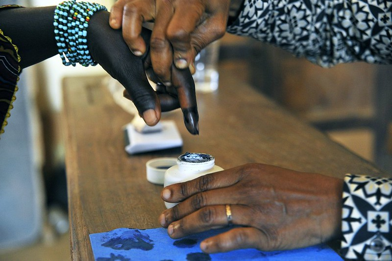 A woman has her finger dipped in ink after voting in legislative by-elections in Grand Laho, Côte d′Ivoire, in 2013. Photo: UN/Hien Macline