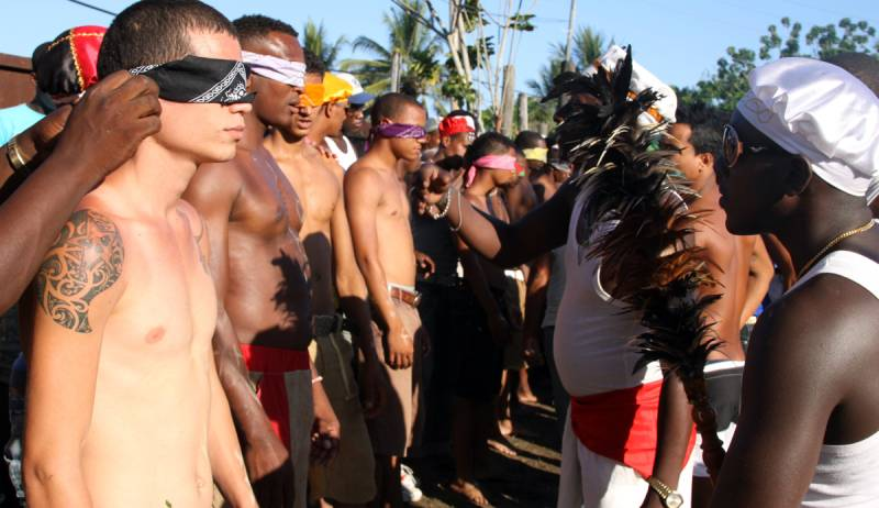 Young men with blindfolds