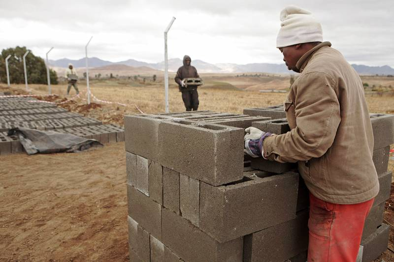 A man carrying building blocks