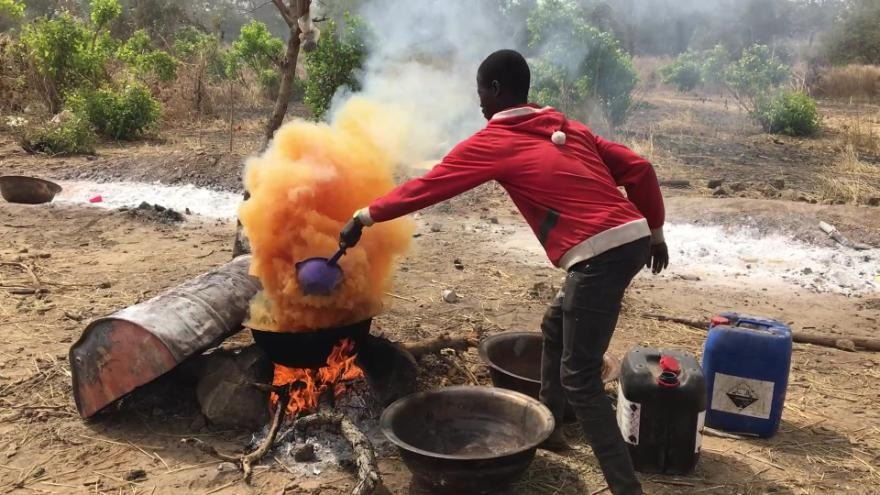 A Burkinabe miner uses cyanide while processing gold