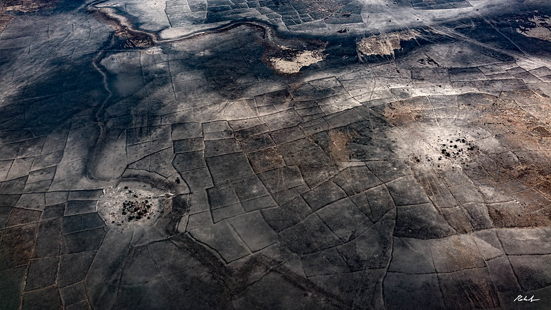 Burned villages and fields, from the UNHAS helicopter transporting humanitarian workers to the camps,