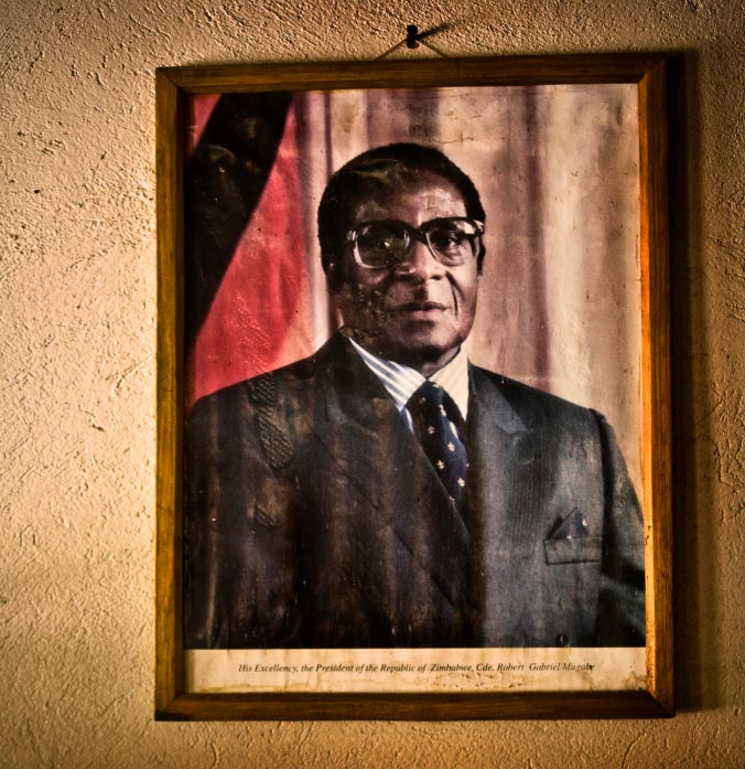 A framed photo of Robert Mugabe on a wall