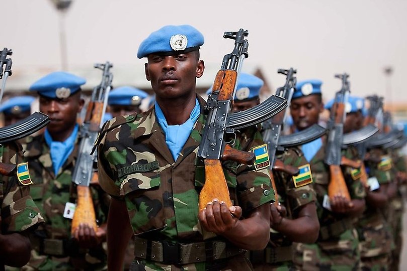 Soldiers (peacekeepers) from UNAMID with blue berets and rifles marching