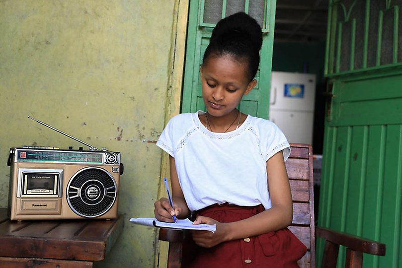 Sehinemariam, 17, a grade 12 student attending classes via a Radio from home.